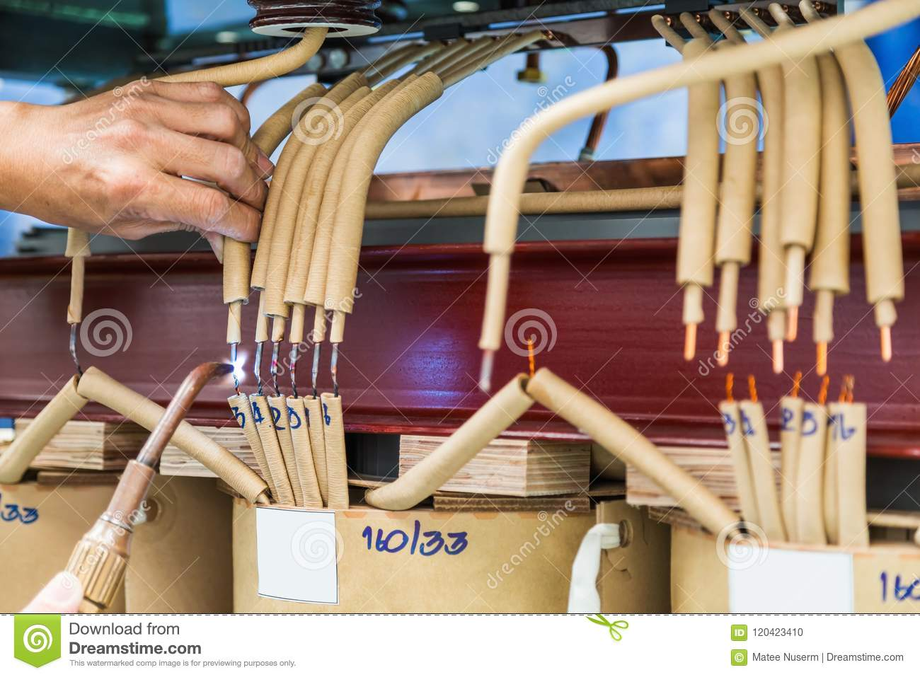 Welding The Tap Leads Of Transformer Stock Photo