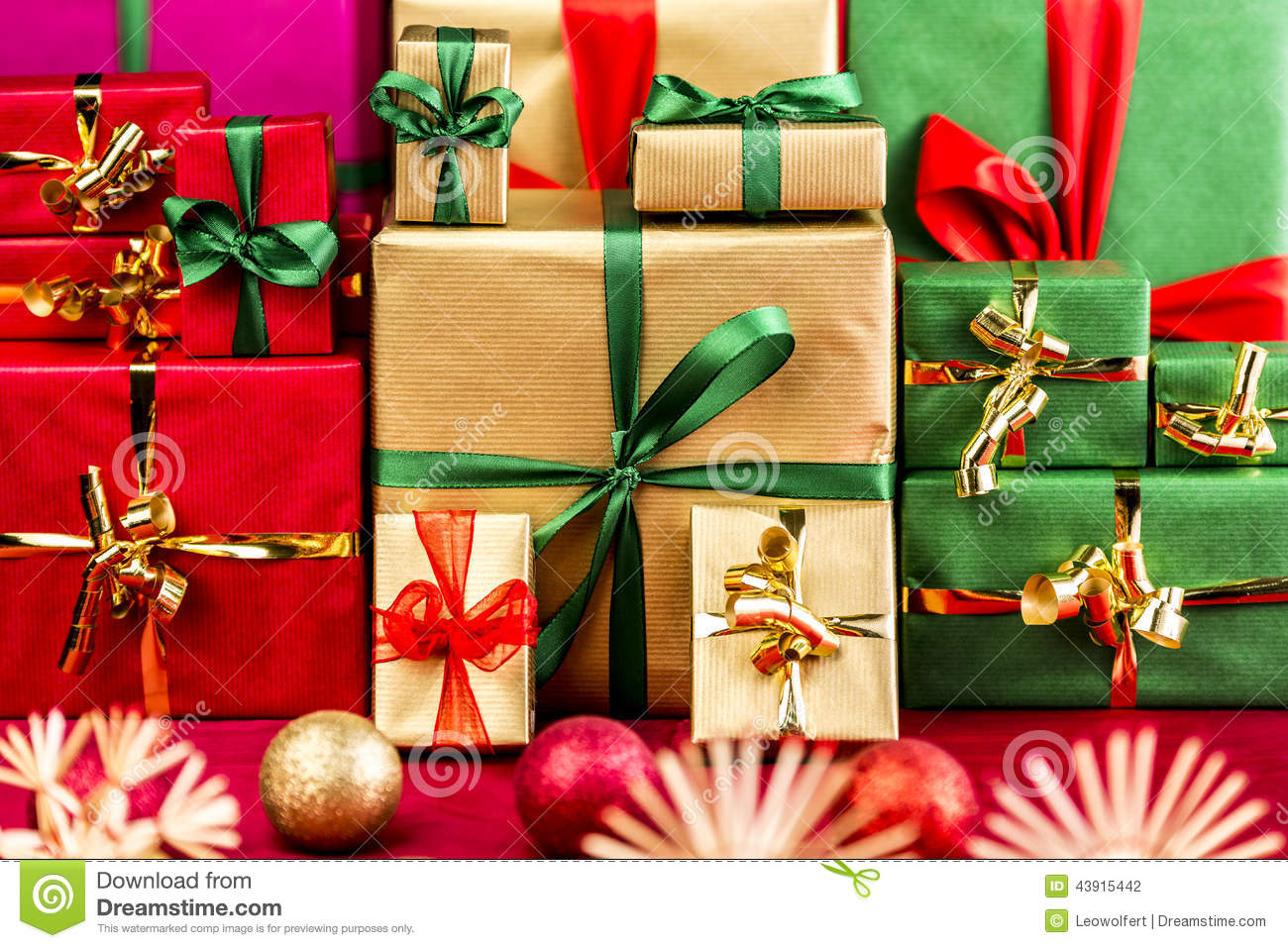 download three piles of xmas gifts in red gold and green stock photo image - Why Are Red And Green Christmas Colors