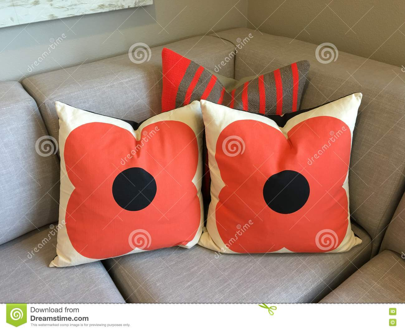 bright brown couch orange pillows