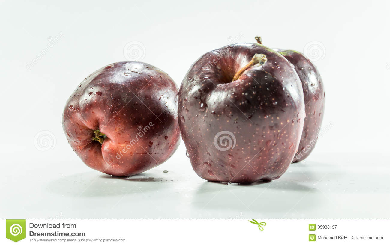 three red apples on white background
