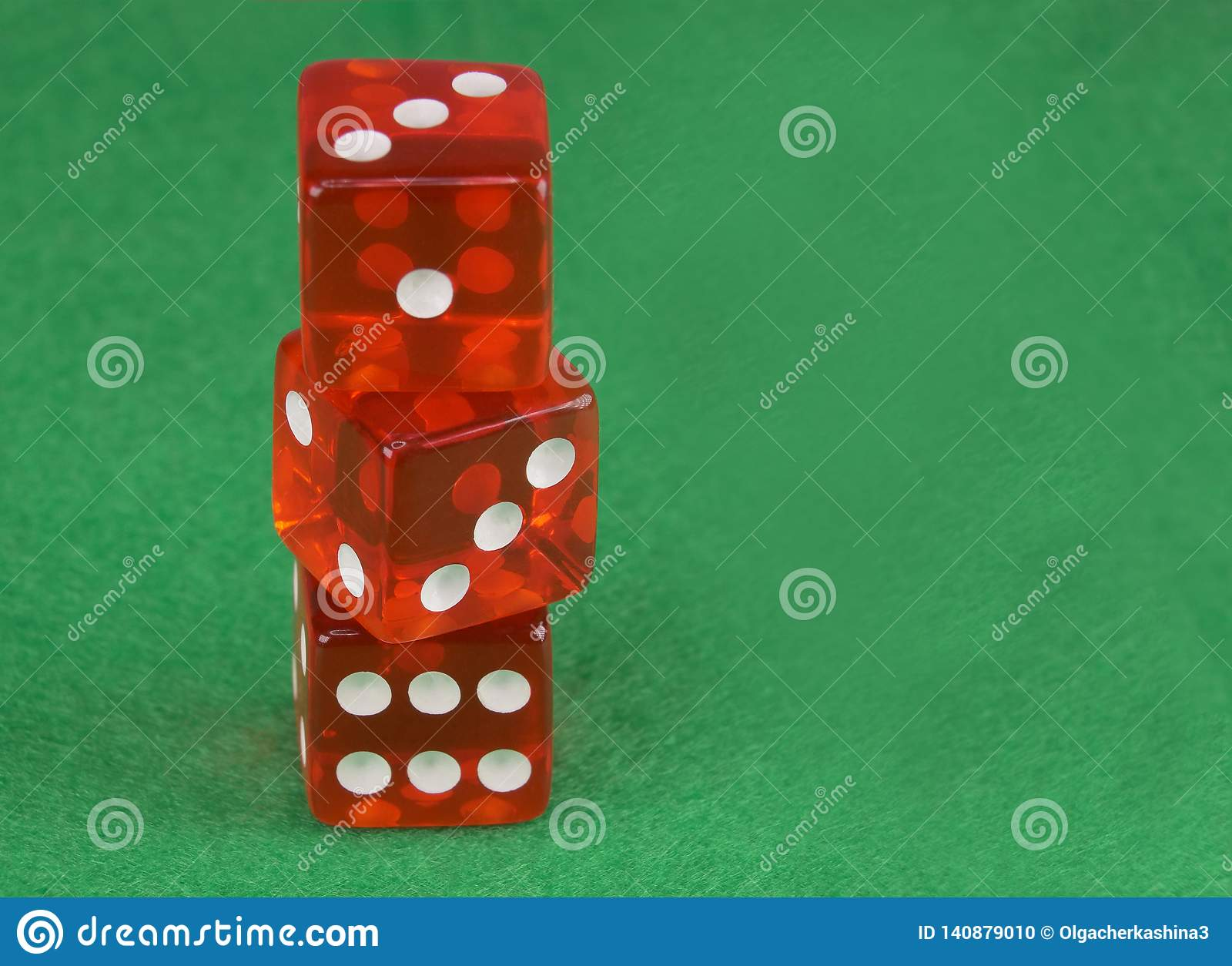 Three red casino dices on green cloth. The concept of online gambling. Copy space for text.
