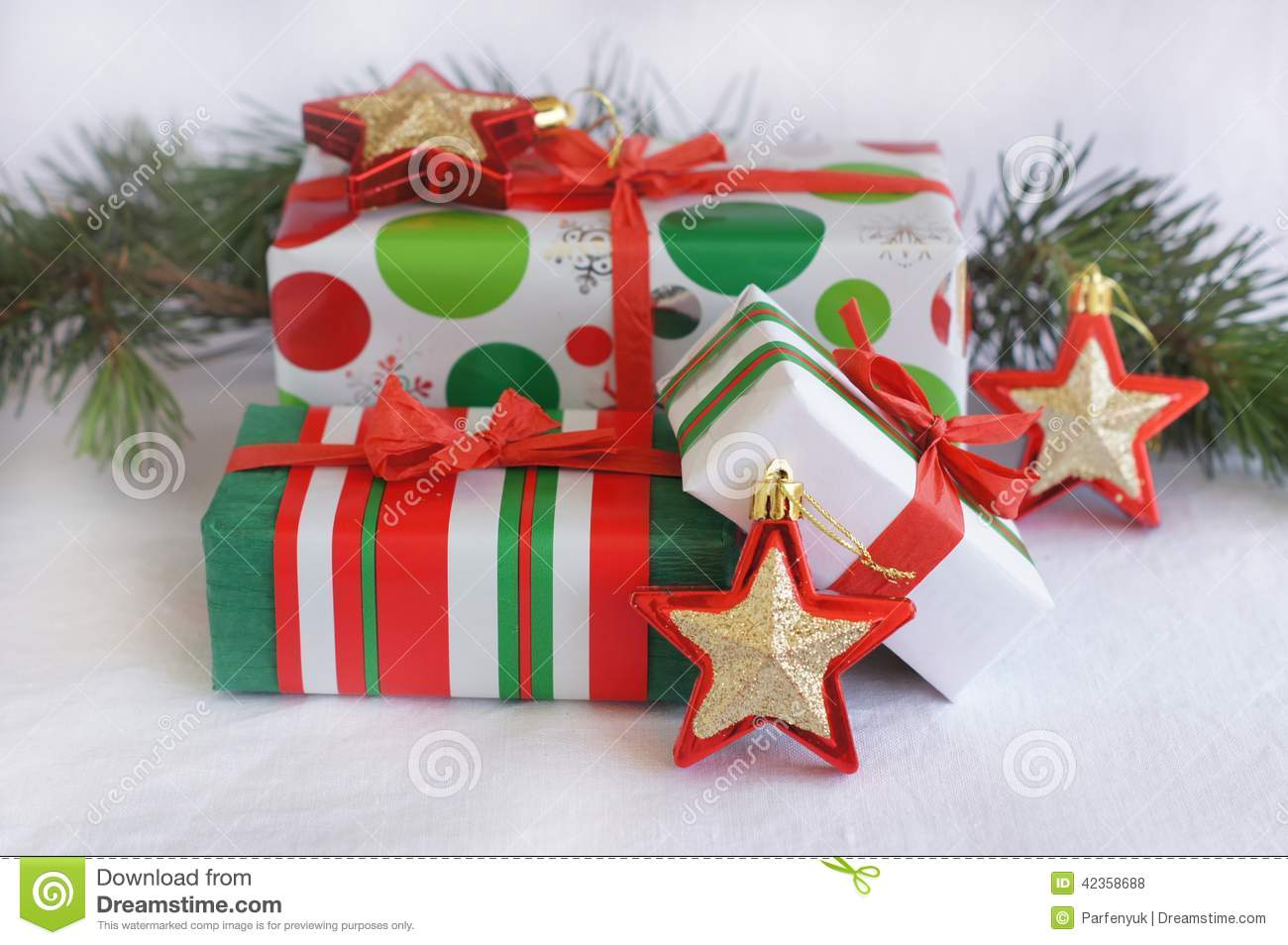 Three red green white christmas gifts with red gol for Red green gold white christmas tree