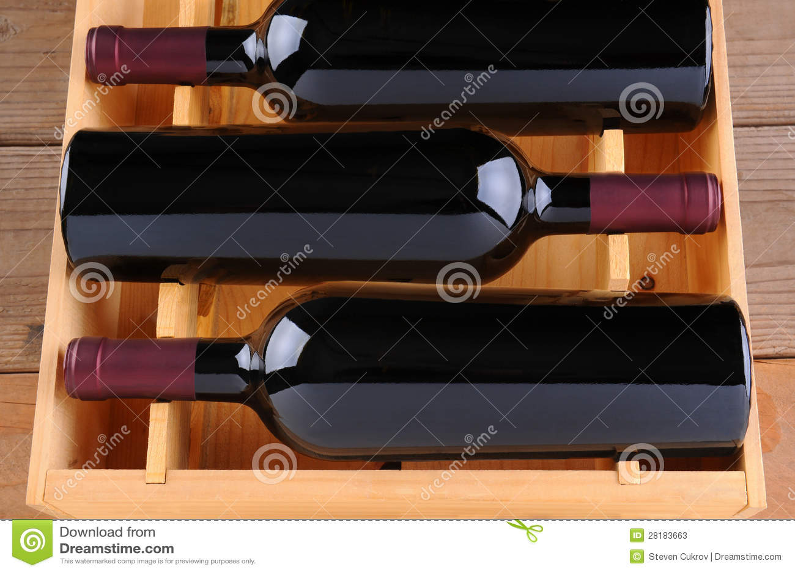 Three Red Wine Bottles in Wood Case