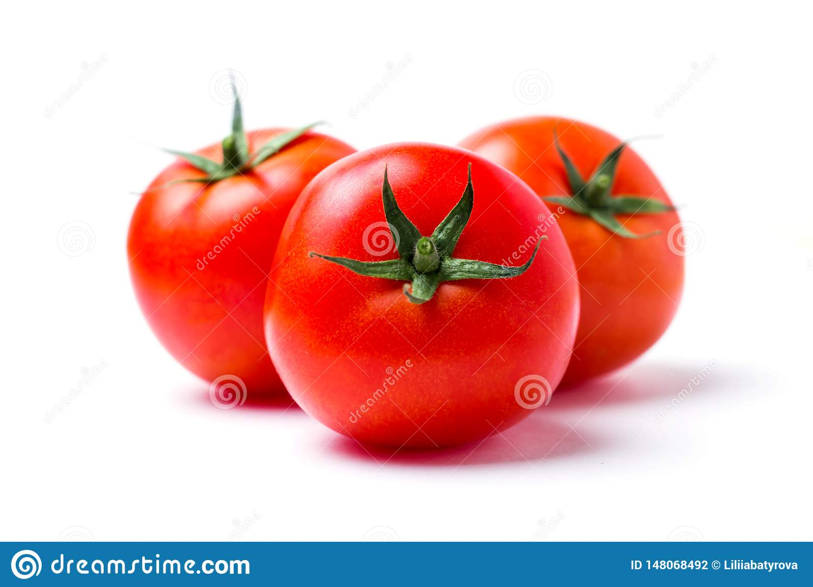 Three ripe red tomatoes on white isolate background, closeup
