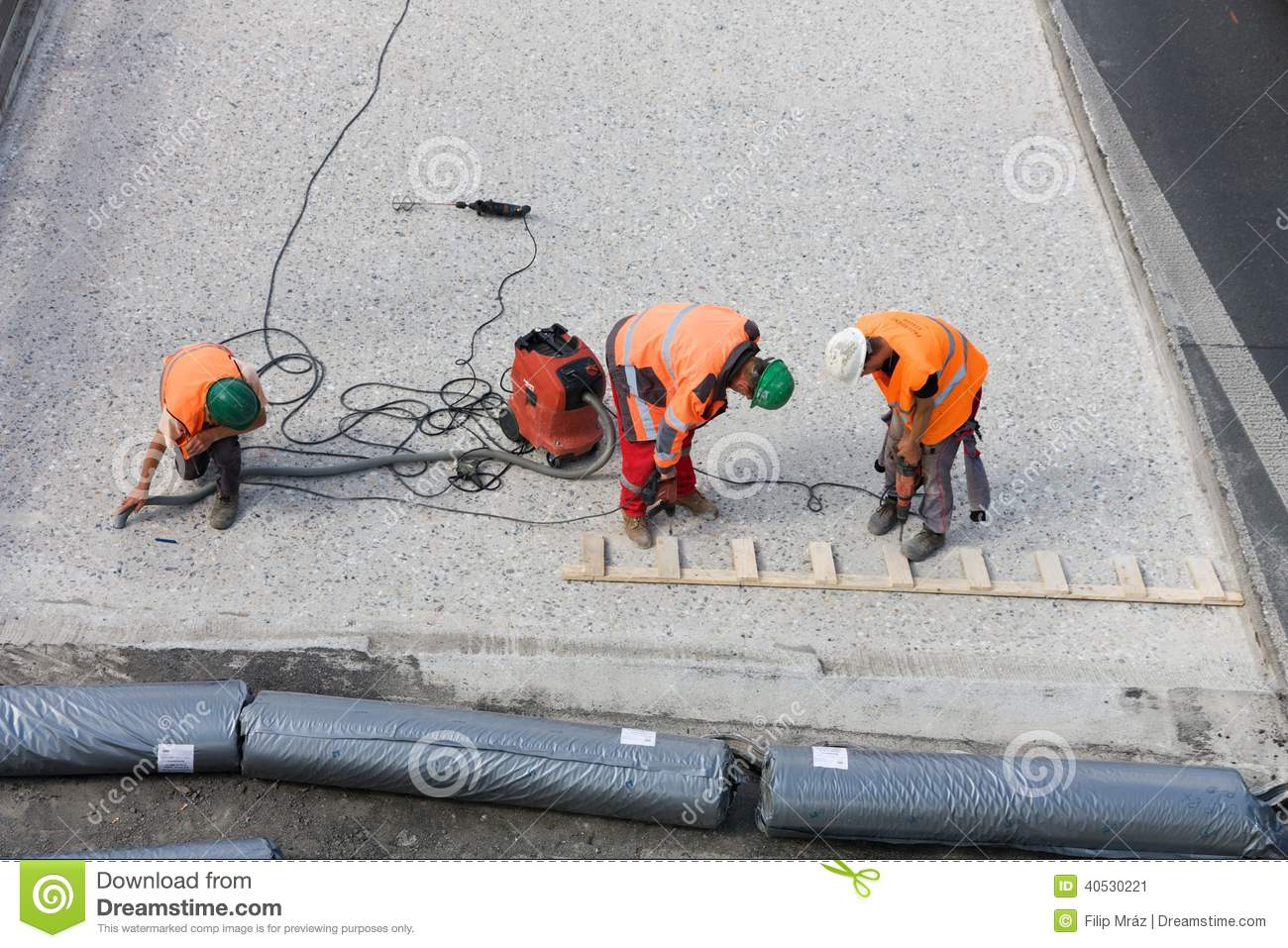 Three road workers