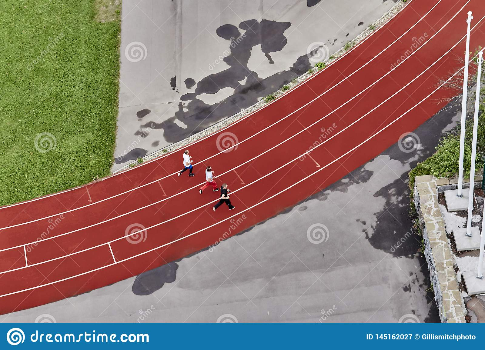 Three runners on a treadmill, top view