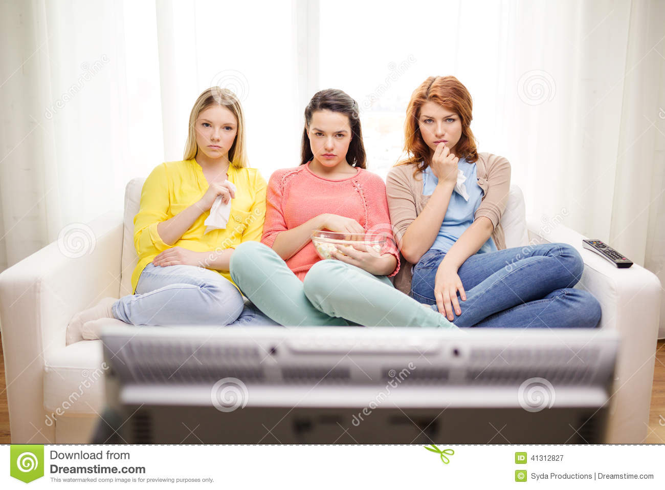 Three Sad Teenage Girl Watching Tv At Home Stock Photo ...