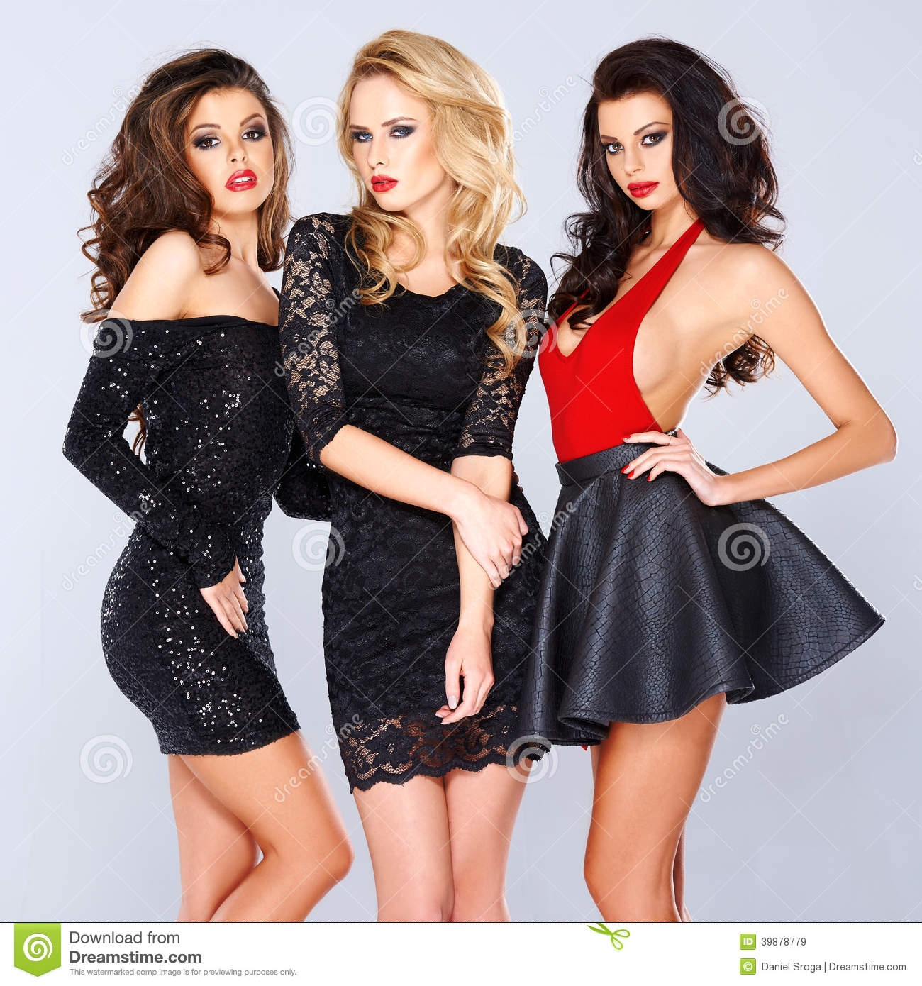 Three elegant women in black evening wear