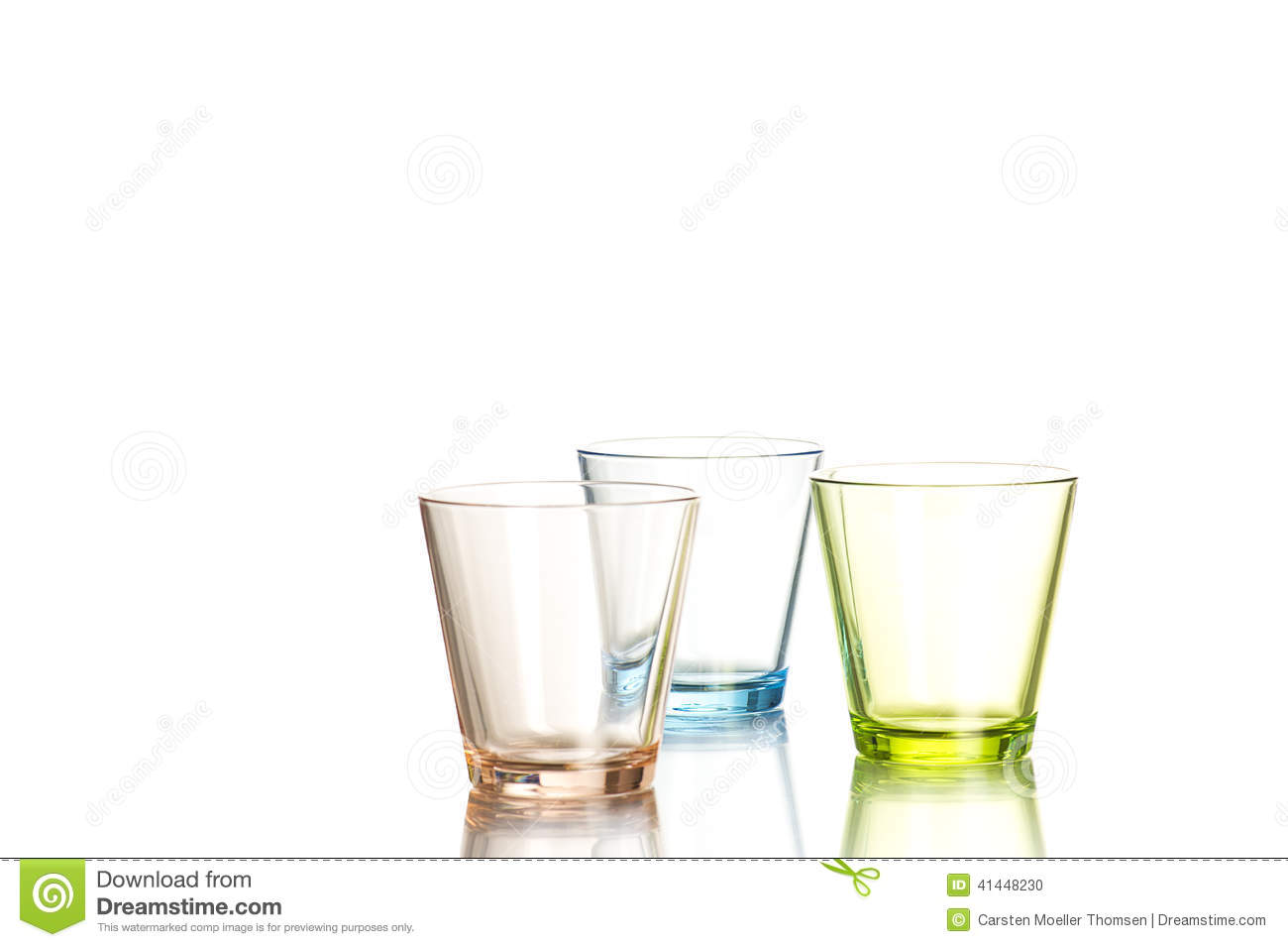 Three shot glasses on white background
