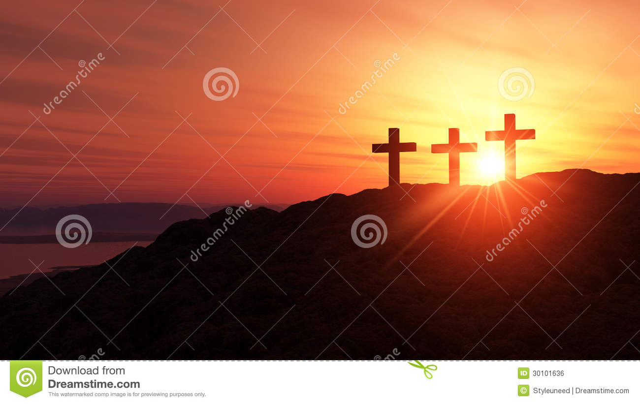 Religious crosses at sunset