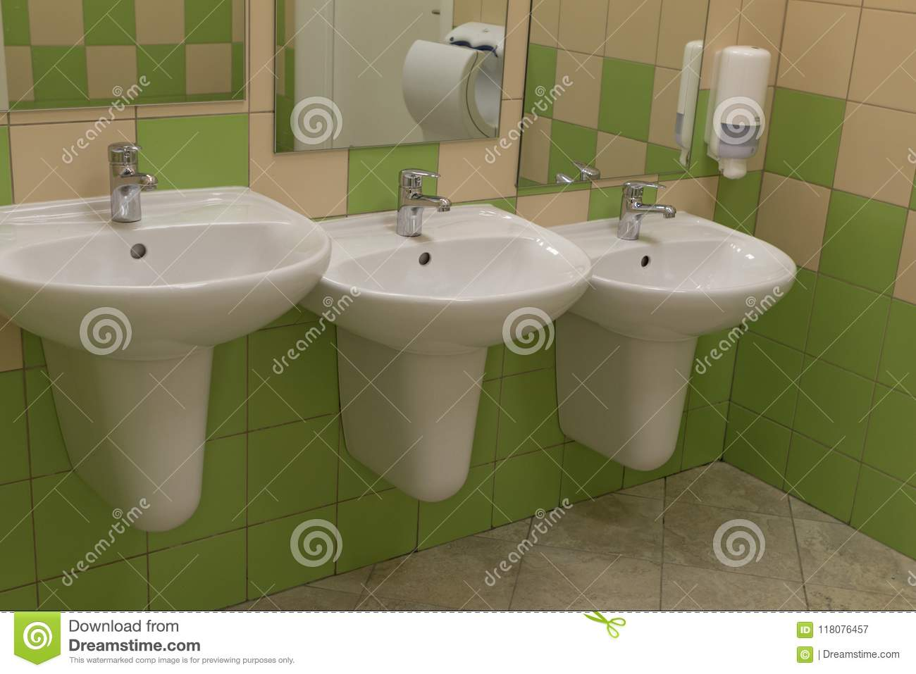 Three Sinks Of Different Heights In A Public Toilet Stock Image ...