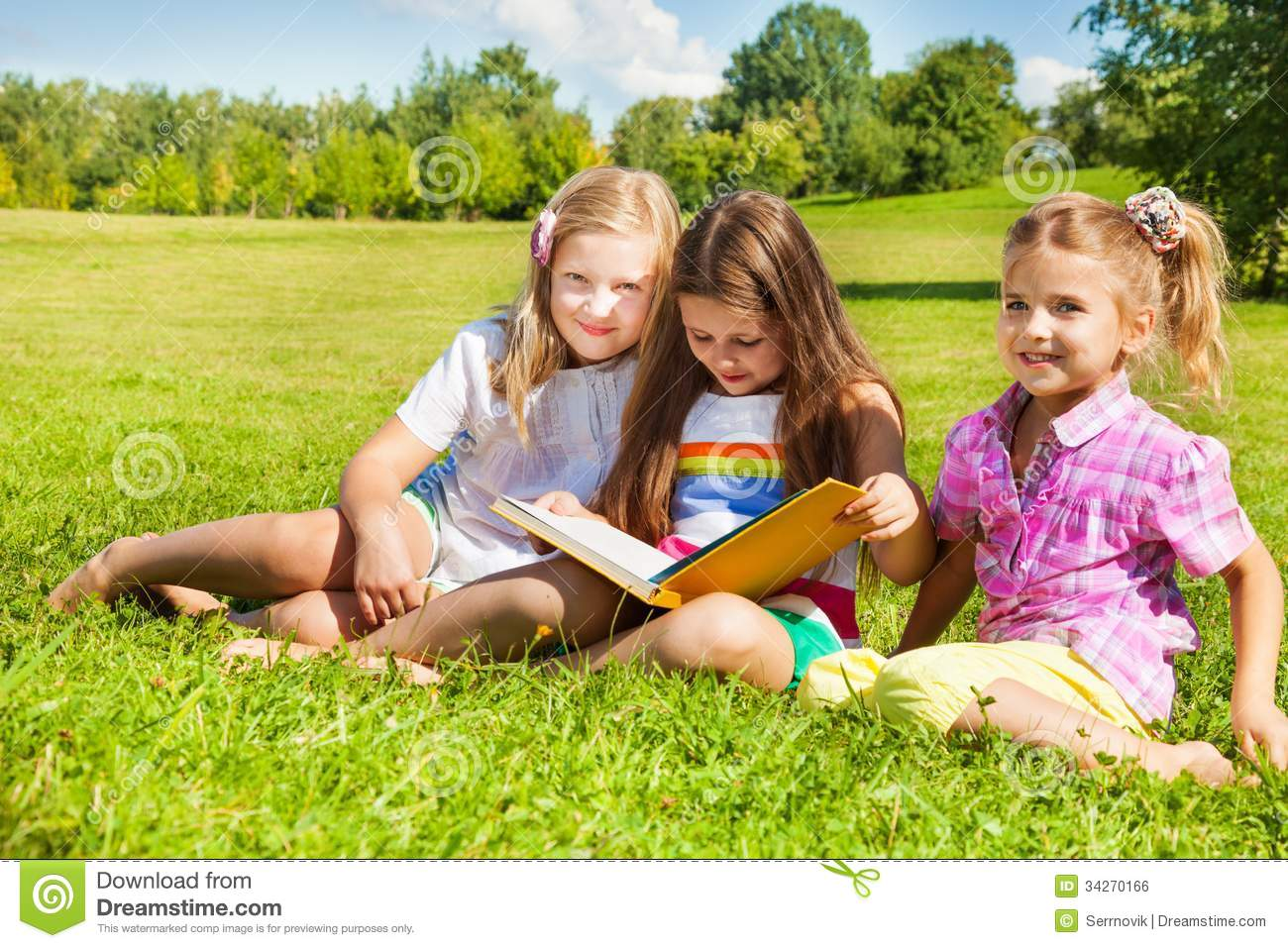 Three Sisters Read Book In The Park Stock Photo Image