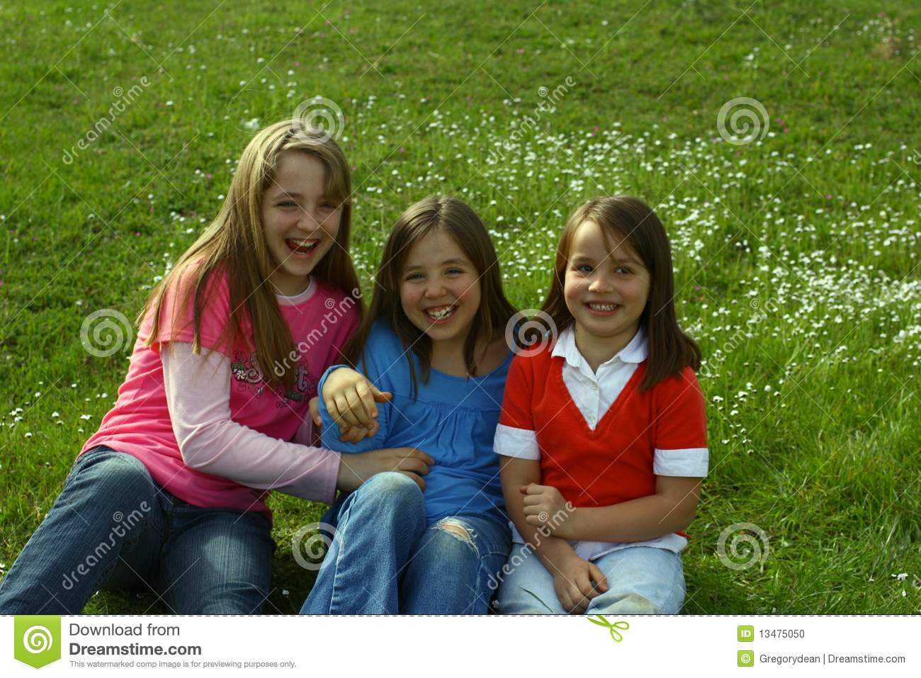 Stock Photo: Three sisters tickling each other