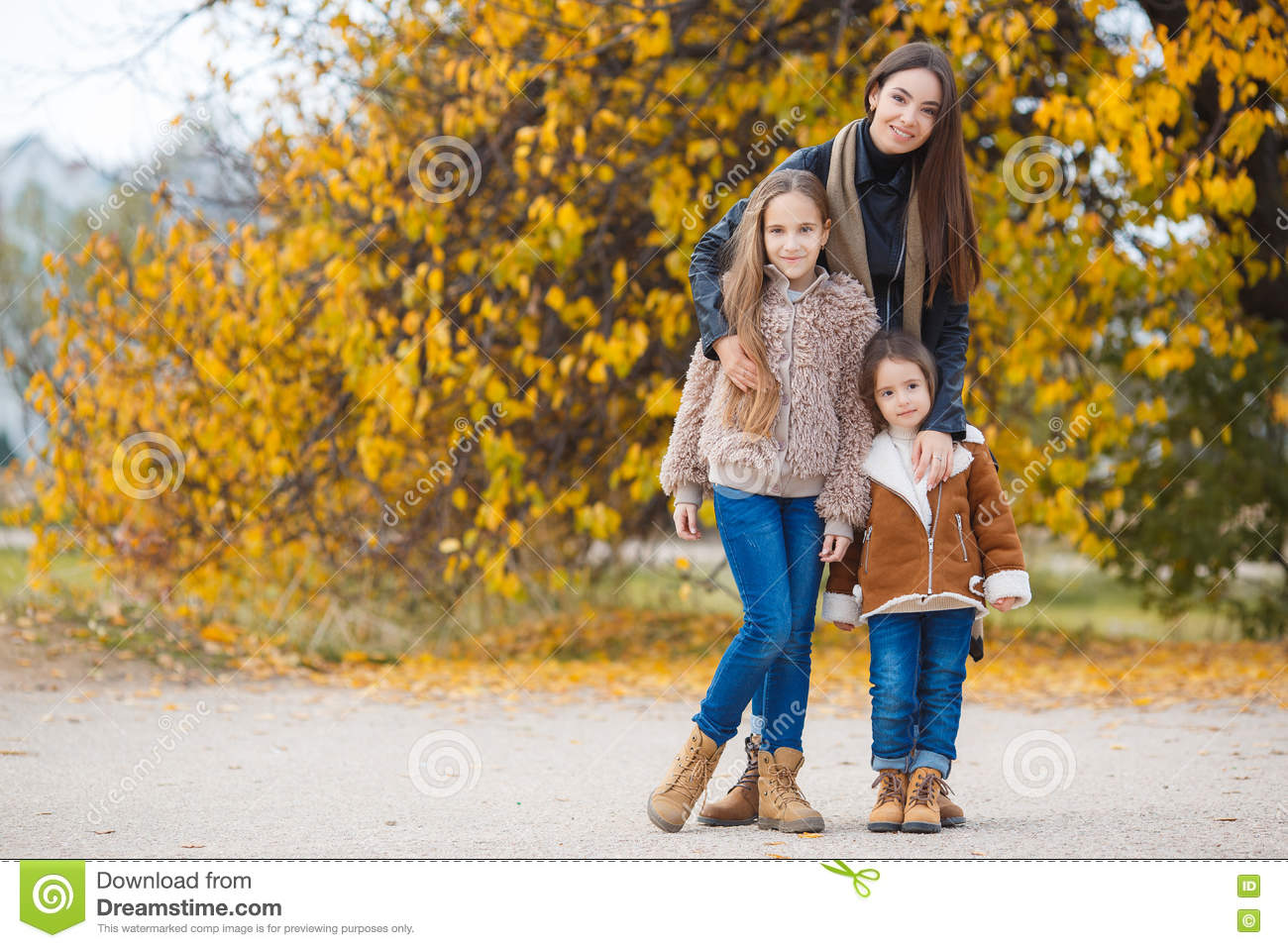 three sisters on walk in autumn park stock image - image of healthy
