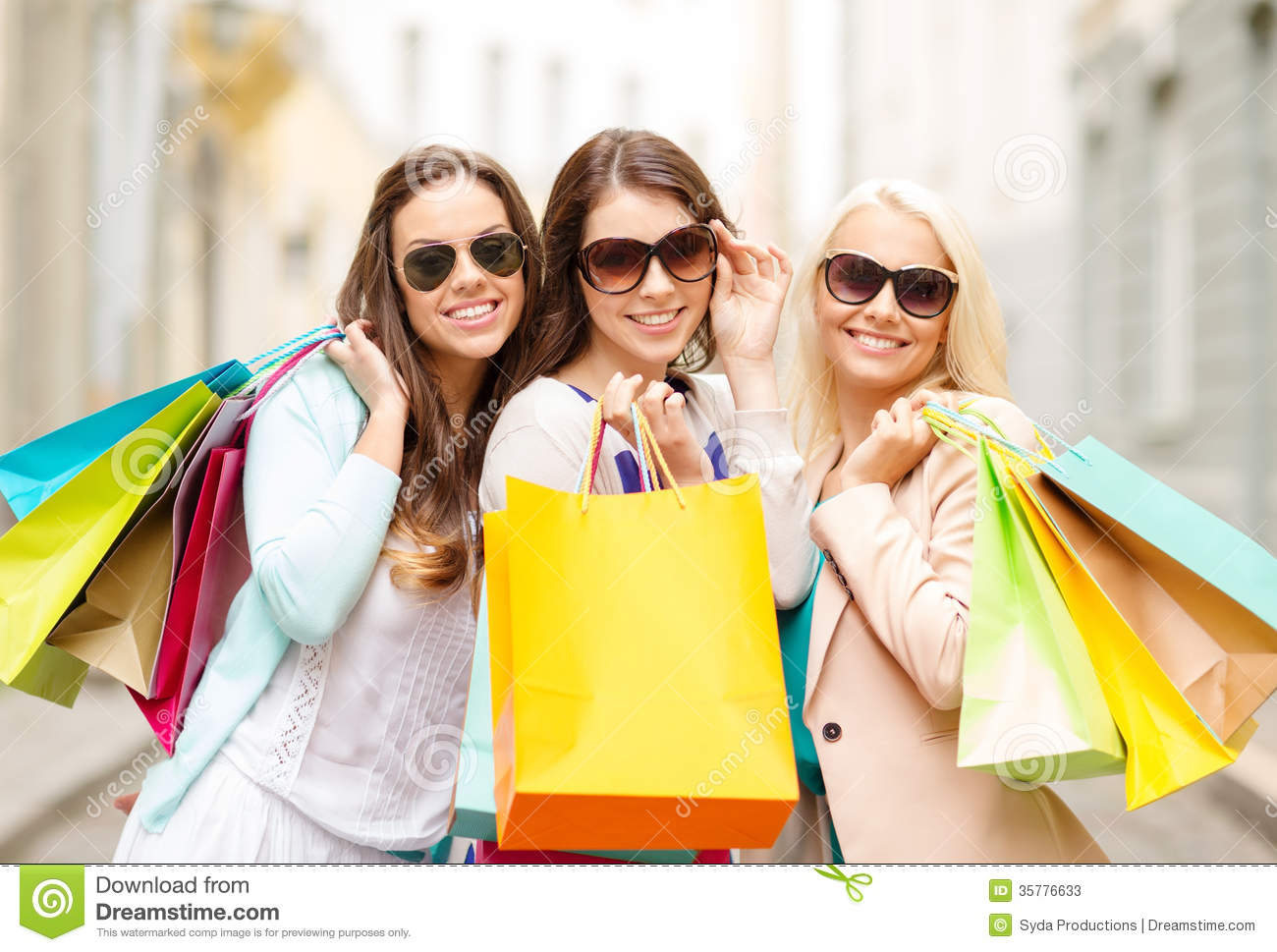Three Smiling Girls With Shopping Bags In Ctiy Stock Photos ...