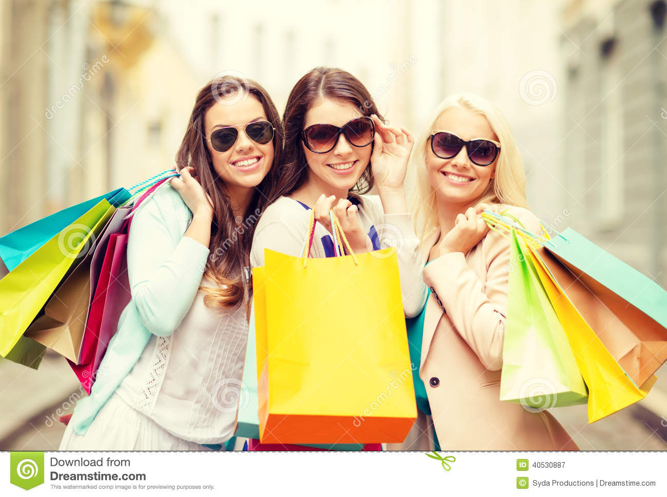 Three Smiling Girls With Shopping Bags In Ctiy Stock Photo - Image ...