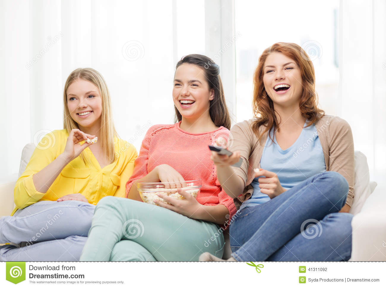 Three Smiling Teenage Girl Watching Tv At Home Stock Photo ...