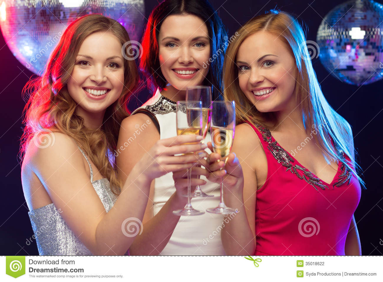 Explore The Beauty Of Caribbean: Three Smiling Women With Champagne Glasses Stock Photo