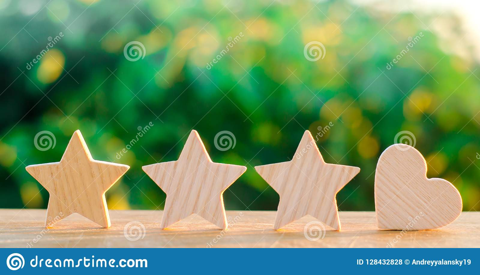 Three stars and heart on a green bokeh background. four star rating, the choice of the editorial office and the buyer. concept of
