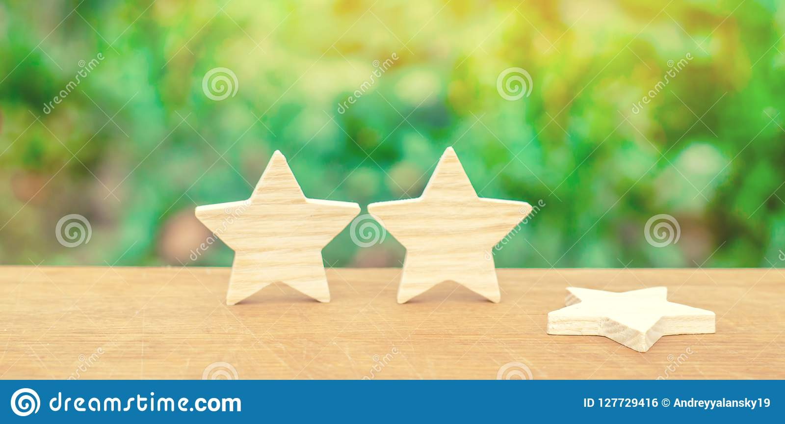 Three stars, a star fell. The concept of a fall in rating and quality. Deprivation of the third star. Feedback on the level
