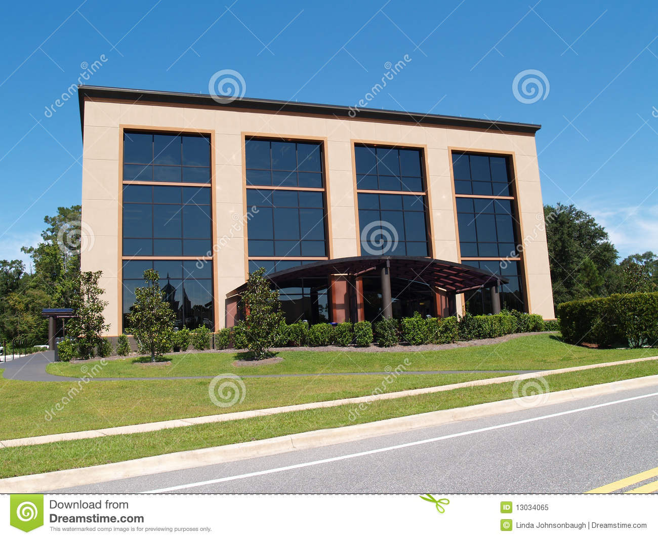 three story office building with glass front royalty free