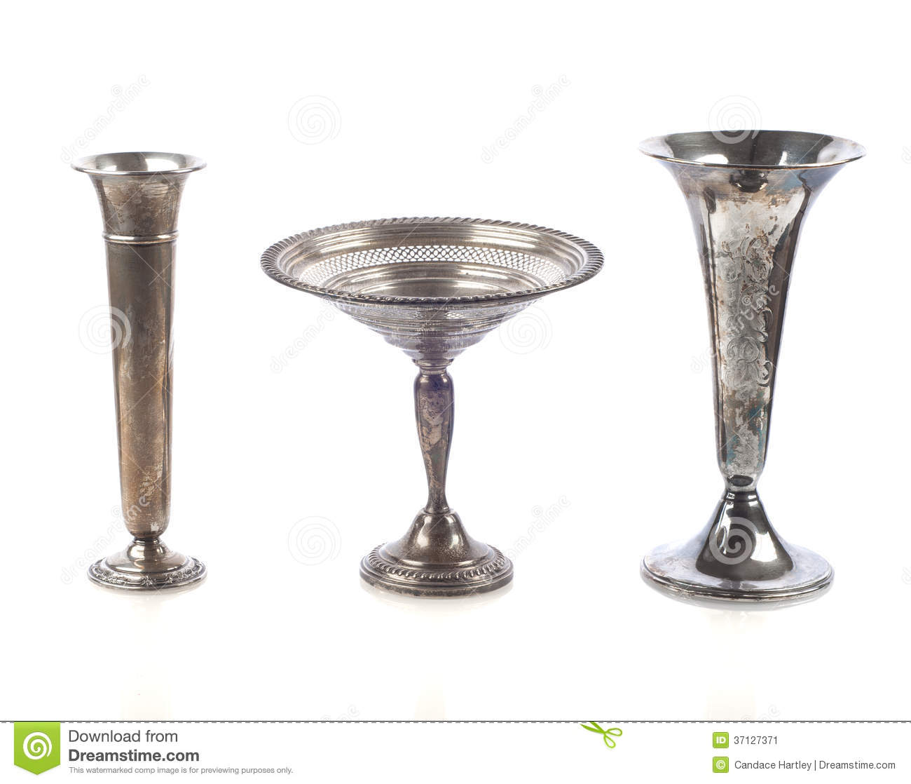 Three Tarnished Silver Vases On White Background With Some Shadows And Reflection Stock Image