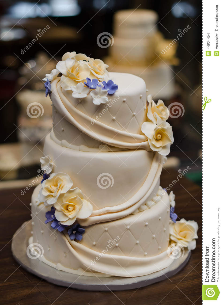 Three Tier Champagne Colored Wedding Cake With Yellow And