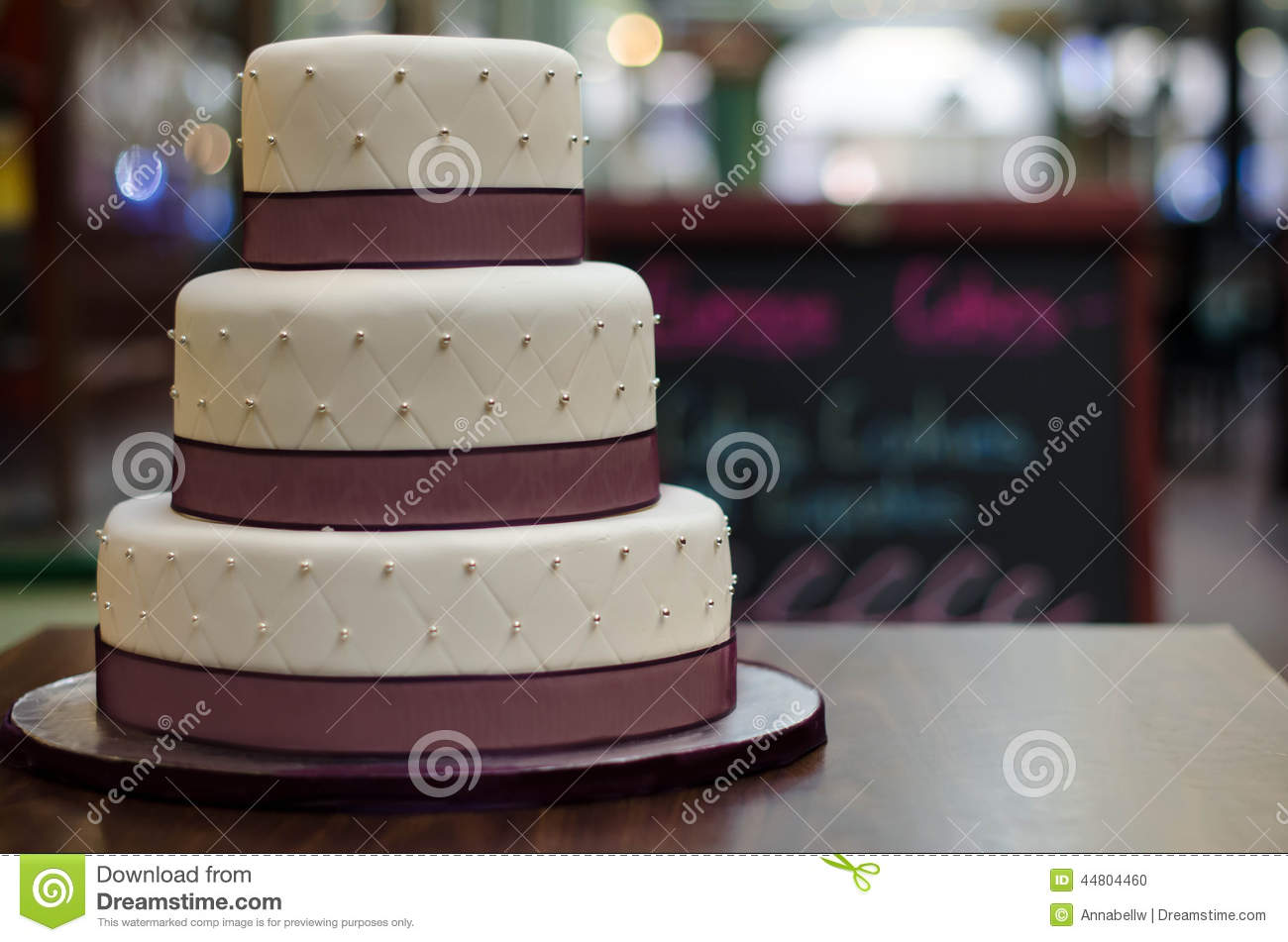 Three Tier White Burgundy Wedding Cake With Pattern And