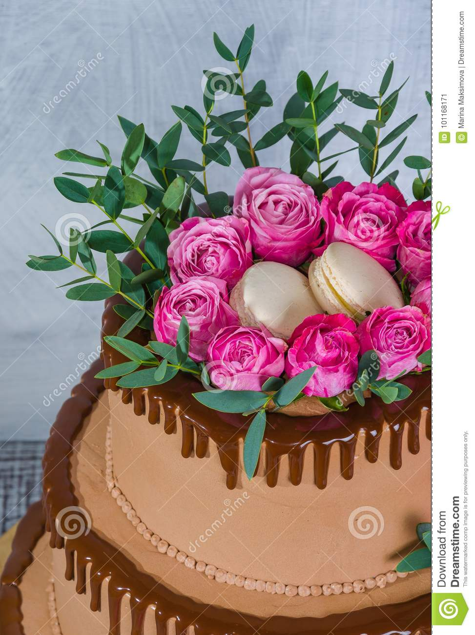 Three-tiered Wedding Chocolate Drip Cake Decorated With Roses Stock ...
