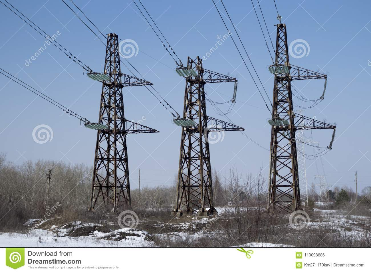 Three Transmission Electric Towers With Background Of Blue Sky Stock ...