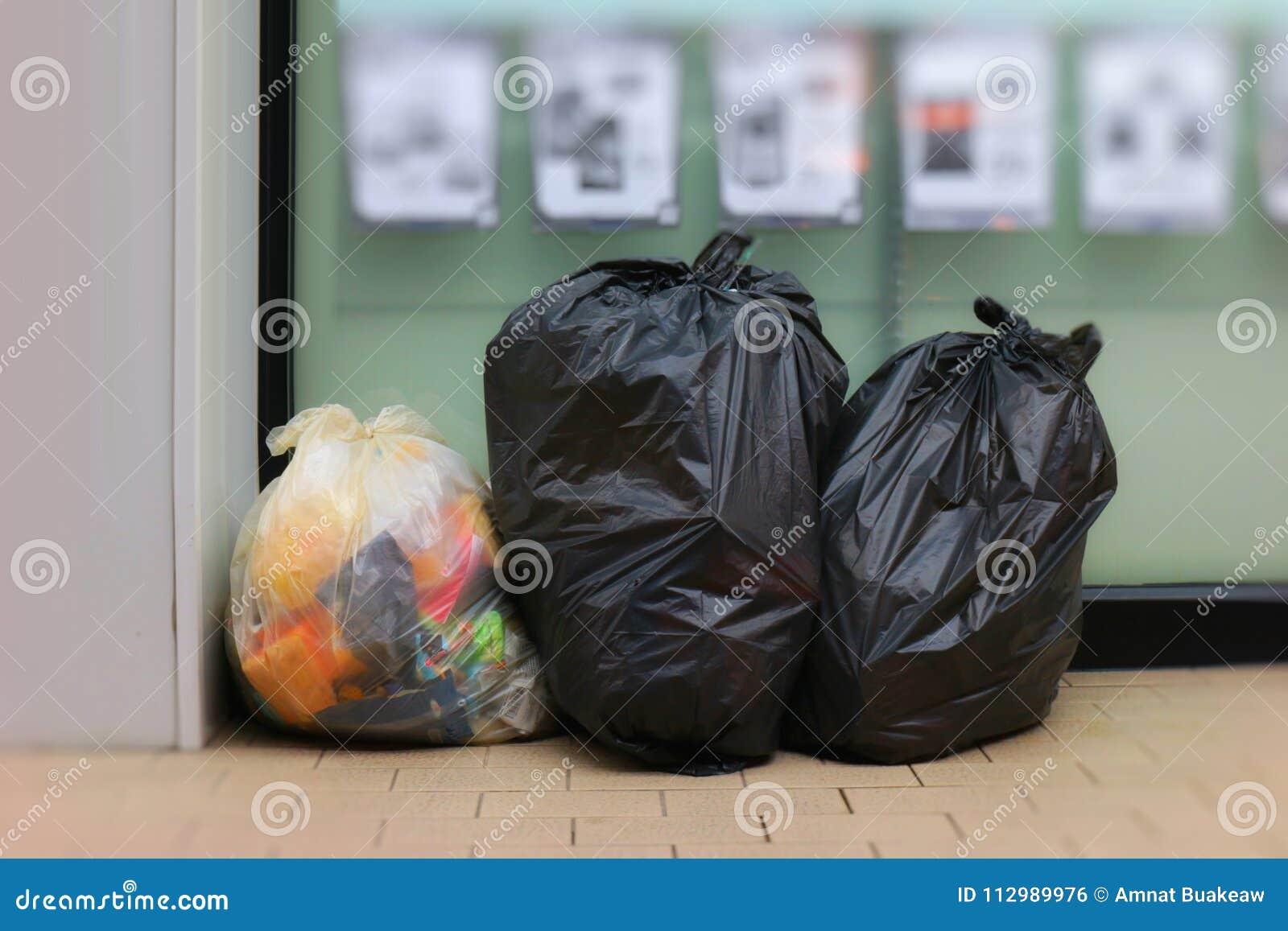 Three Trash Bags, Garbage bag black placed front convenience store, Bin, Trash, trash bag, trash on sidewalk, Three bags bin of ga