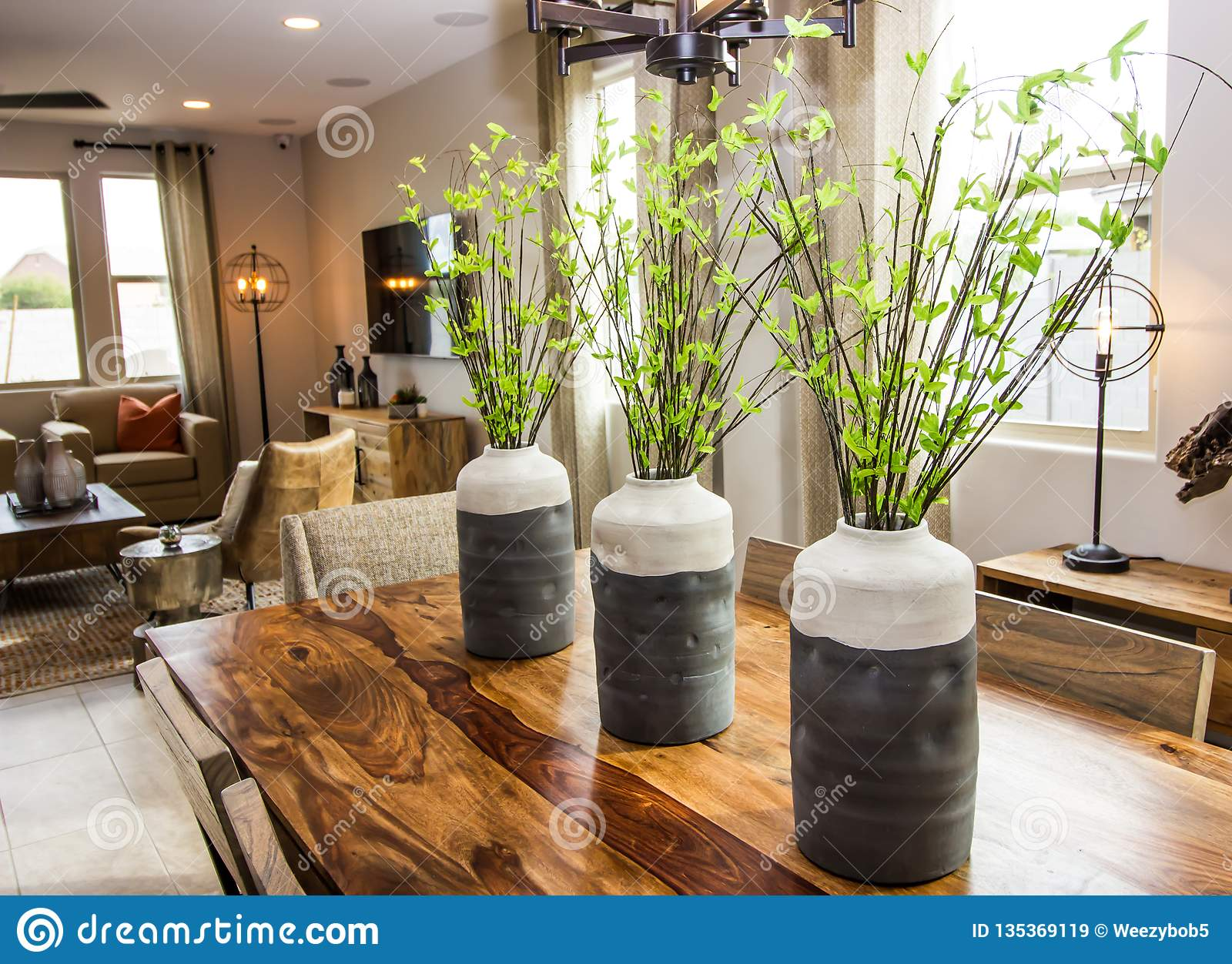 Three Vases As Centerpieces On Wooden Table Stock Image Image Of Pillow Walls 135369119