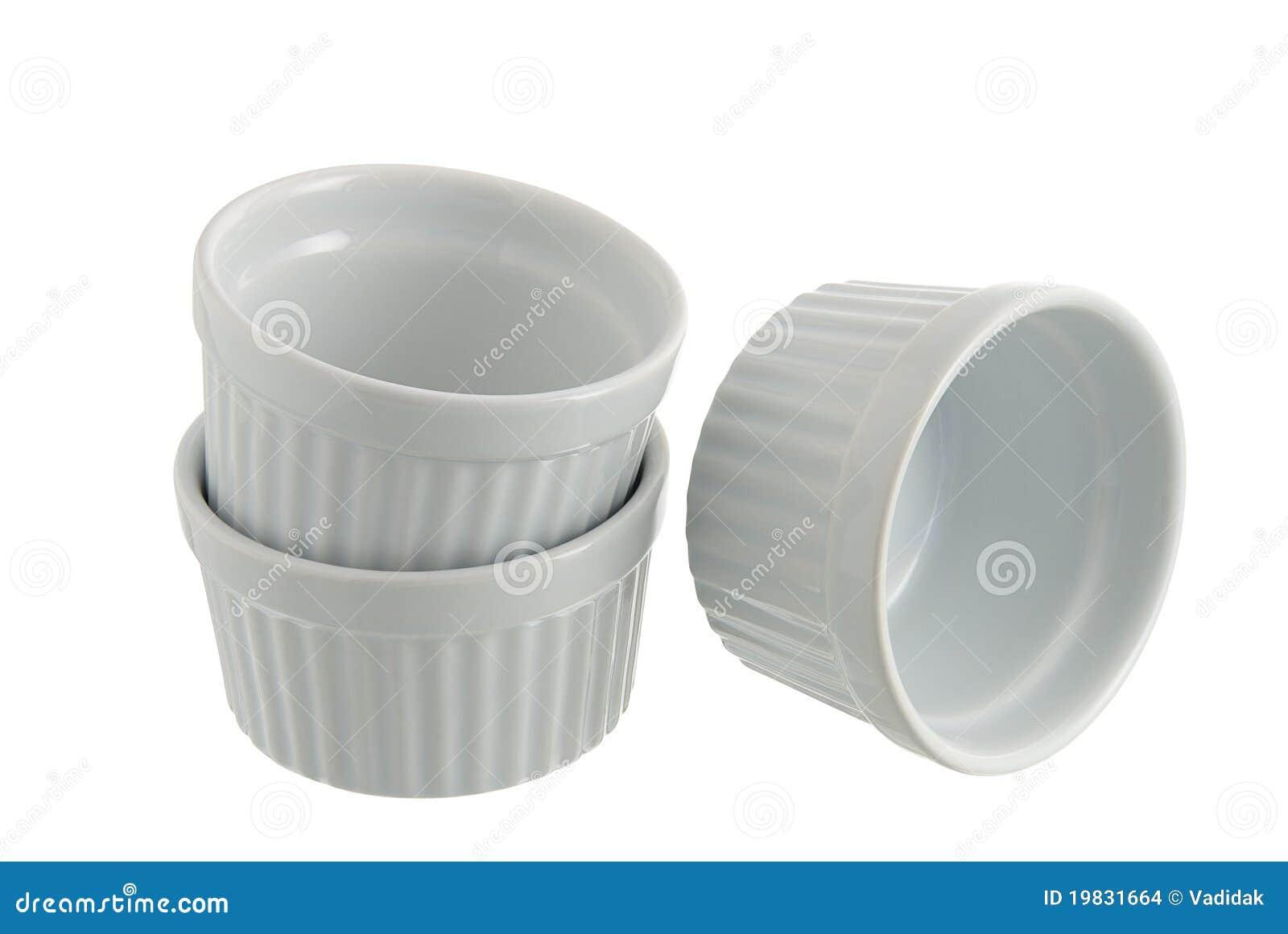 Three White Ceramic Individual Baking Pans Stock Photo