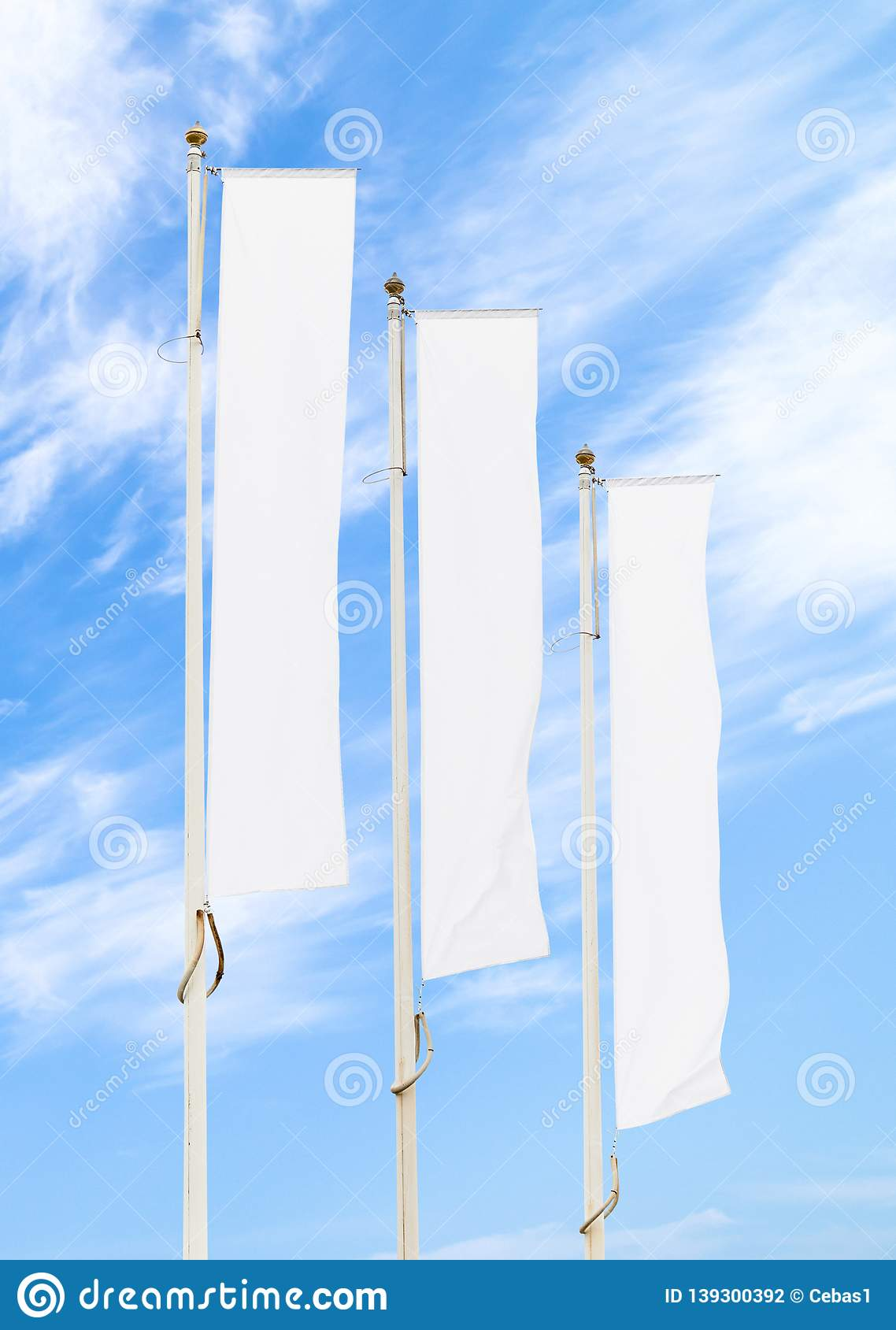 Three white corporate flags mockup against blue sky