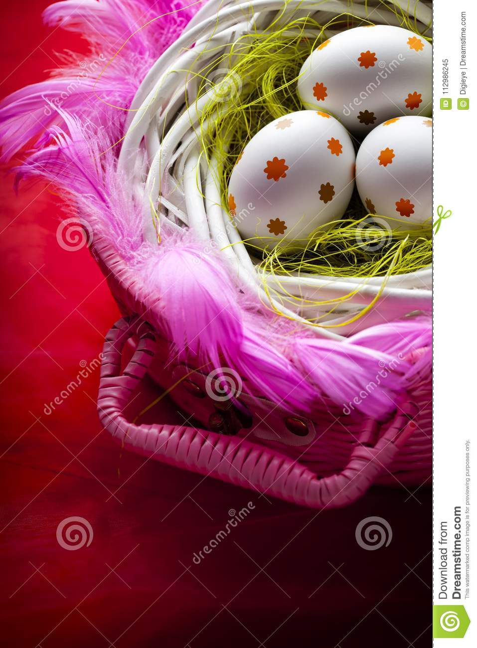 Three white Easter eggs in the nest on red background