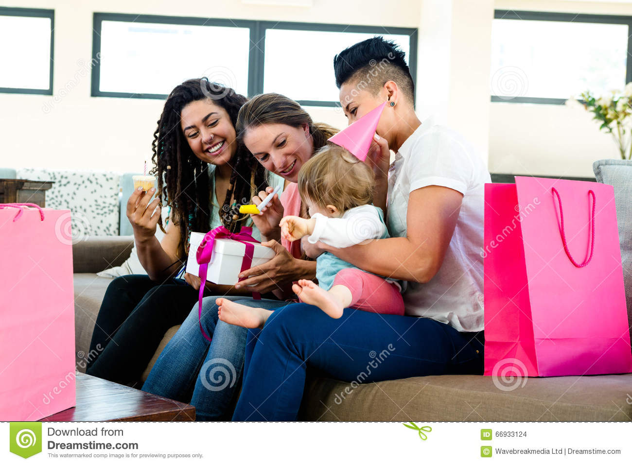 Three women celebrating a babies first birthday