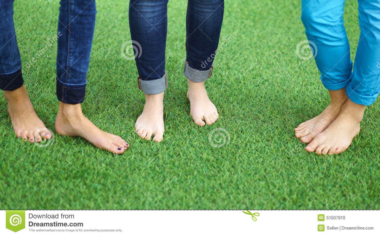 three women with naked feet standing in grass stock photo - image of