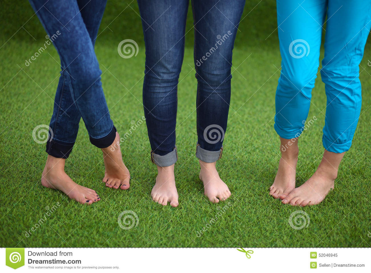 three women with naked feet standing in grass stock image - image of