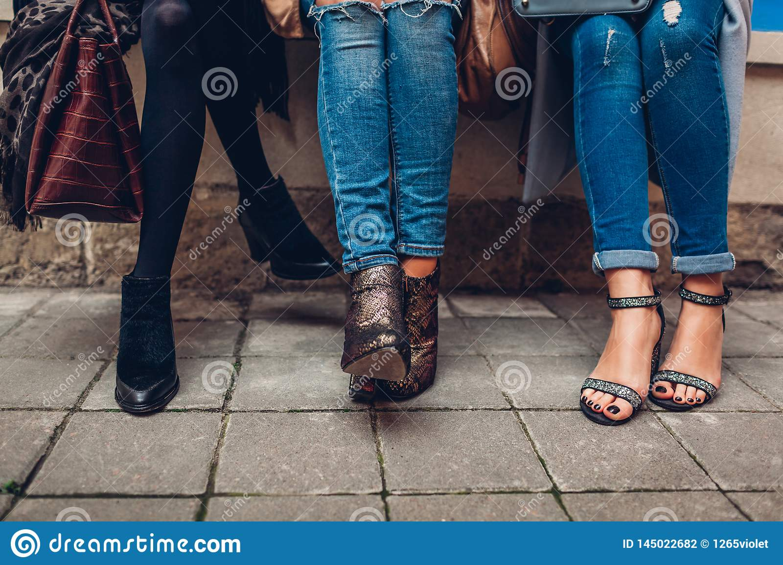 Three Women Wearing Stylish Shoes And Accessories Outdoors