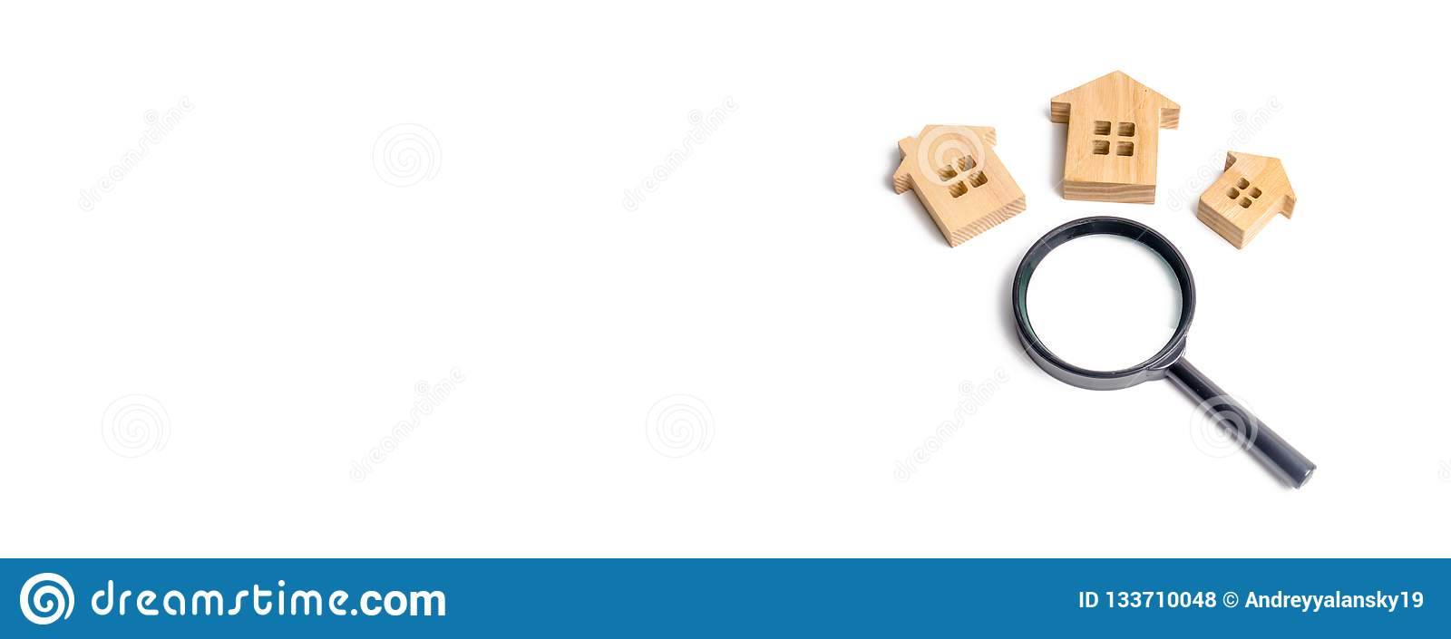 Three wooden houses on a white background. Buying and selling real estate, building new buildings, offices and homes. House search