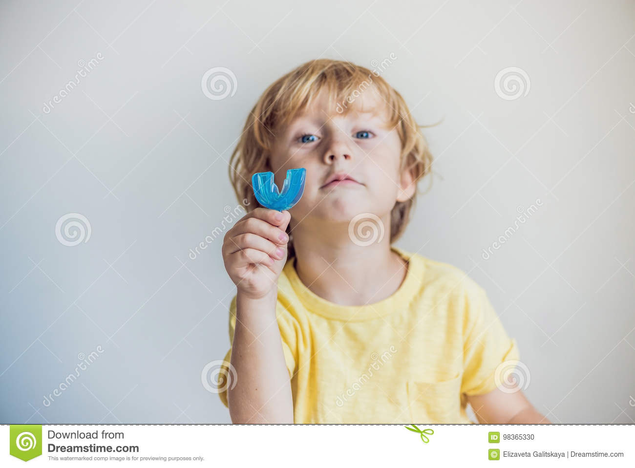 Three-year old boy shows myofunctional trainer to illuminate mouth breathing habit. Helps equalize the growing teeth and correct