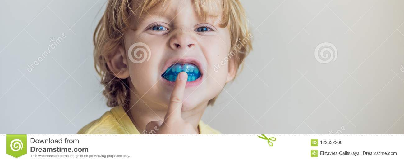 Three-year old boy shows myofunctional trainer to illuminate mouth breathing habit. Helps equalize the growing teeth and correct b