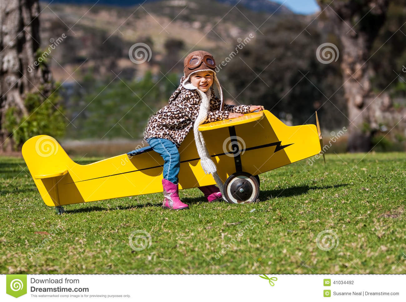 Airplane Toys For 3 Year Olds : Three year old girl on yellow toy airplane outdoors stock