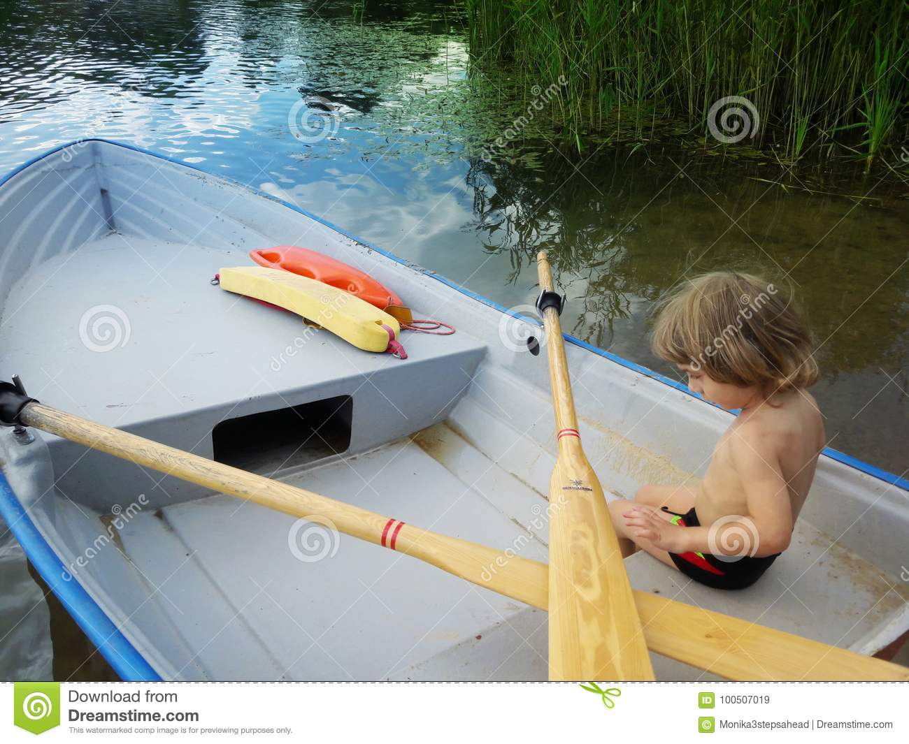 Three years old boy on a boat