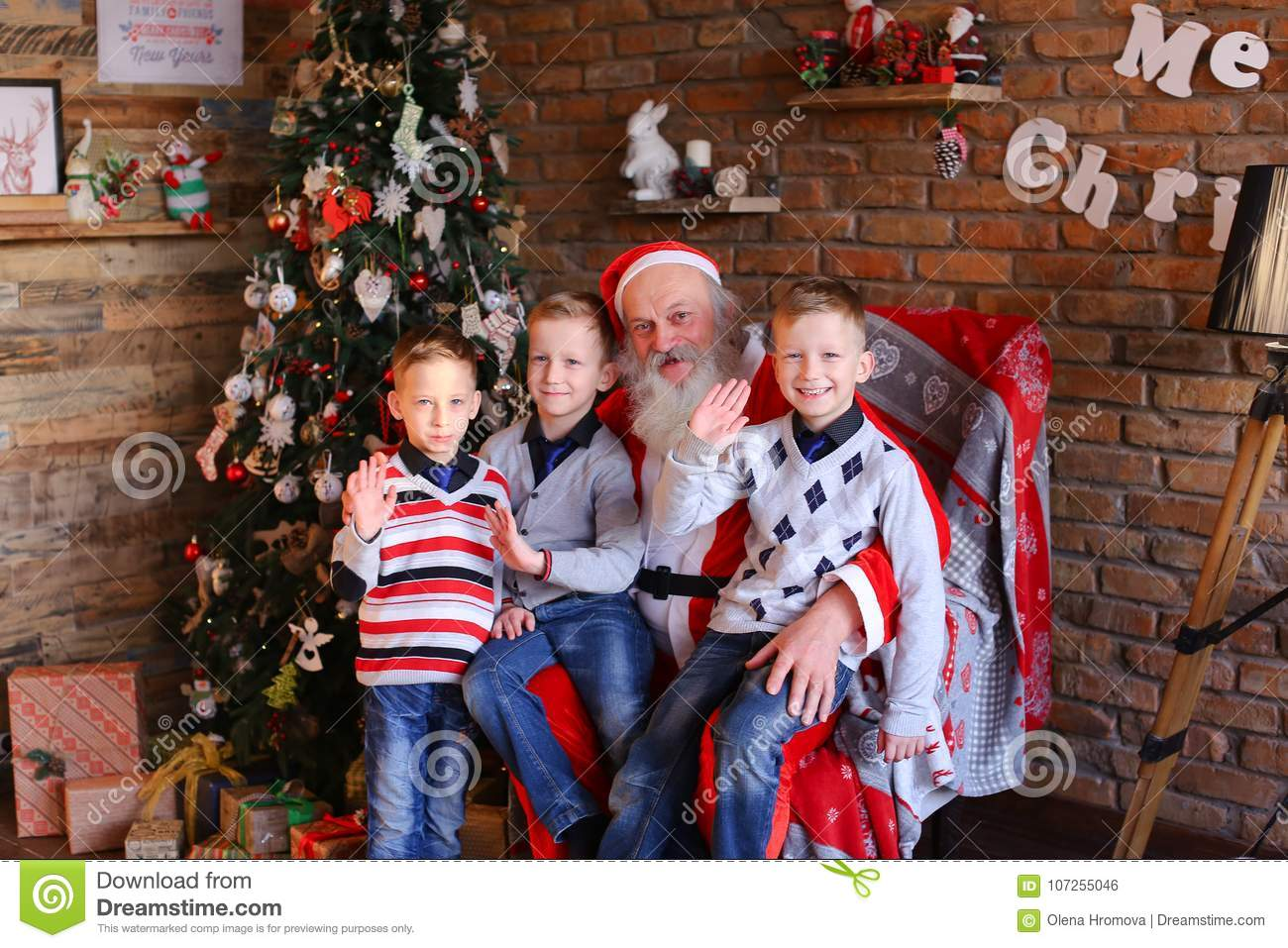 Three Young Boys Tell Santa Claus Funny Stories In Decorated In ...