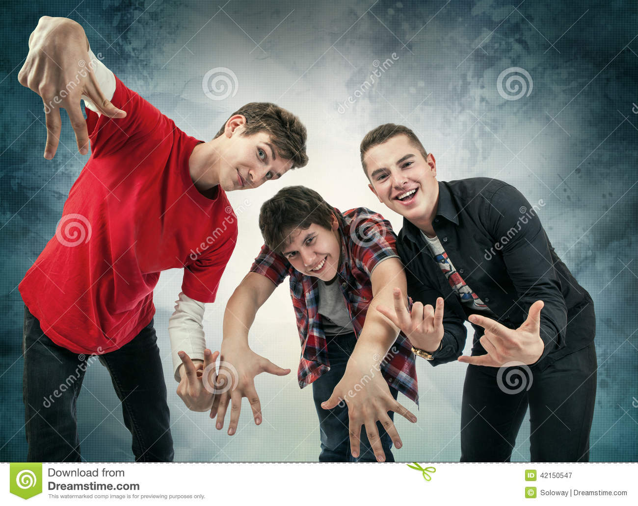 Three Young Man In Fun Hip Hop Poses Stock Image - Image of