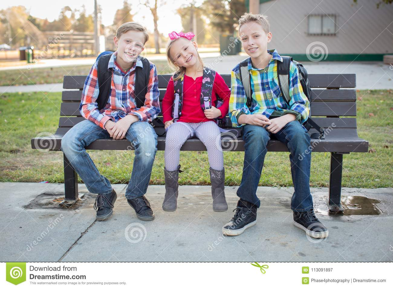 Three Young School Kids Sitting On A Bench Stock Image - Image of ... ca9d408e5df8c