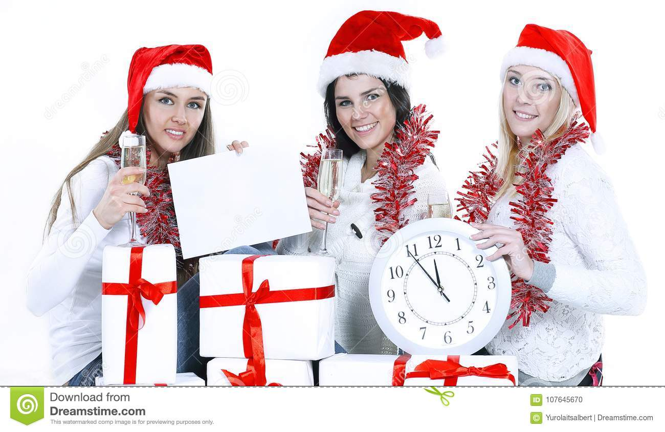 Three Young Women In Hats Of Santa Claus With Christmas Gifts F ...