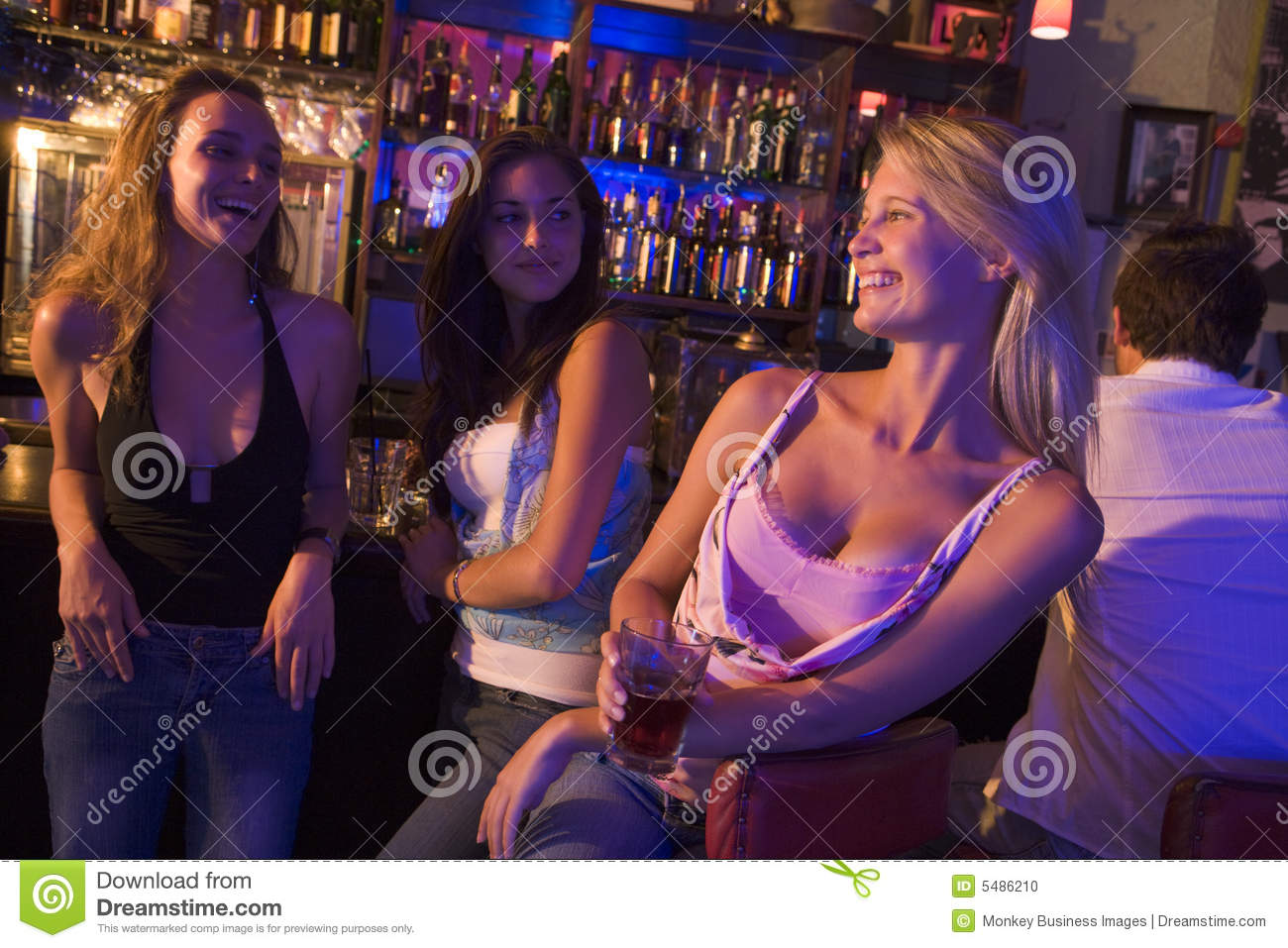 Three young women have drinks