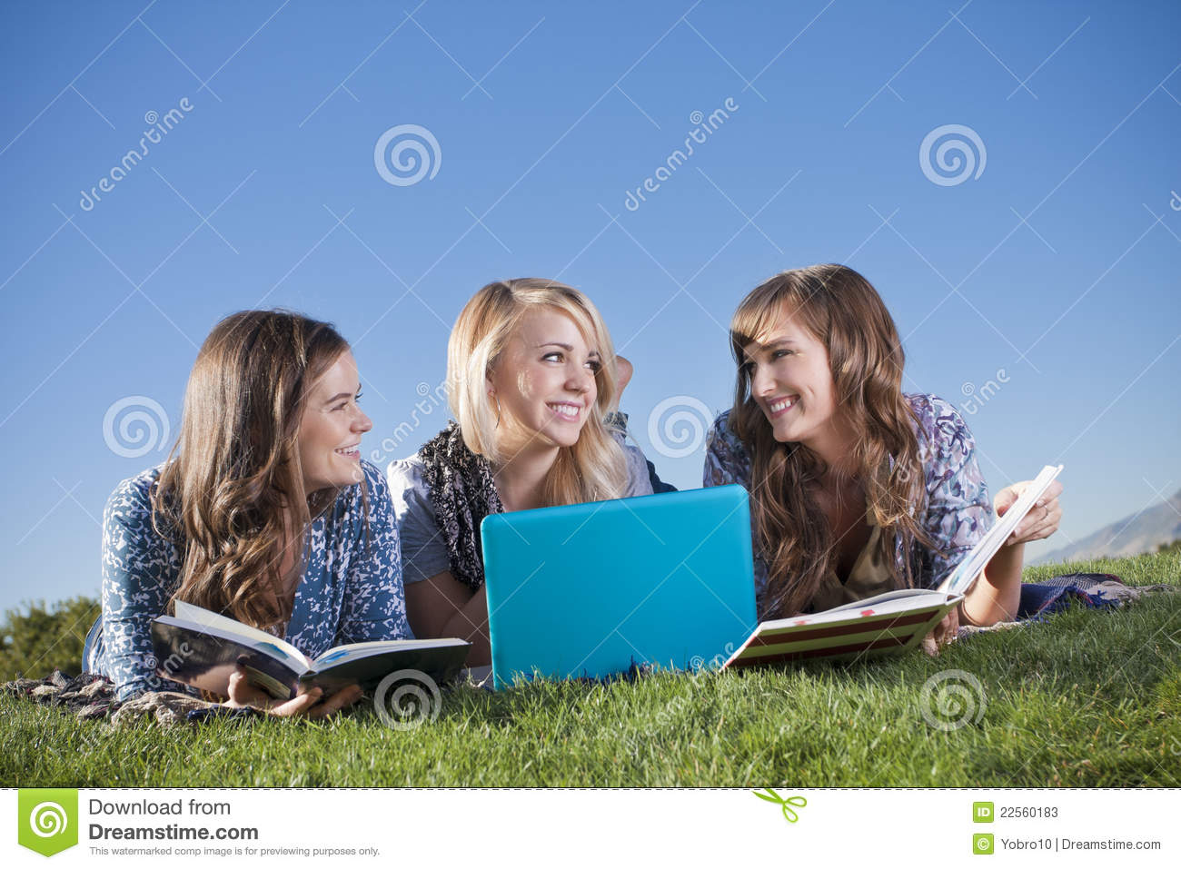 Three Young women studying in the outdoors